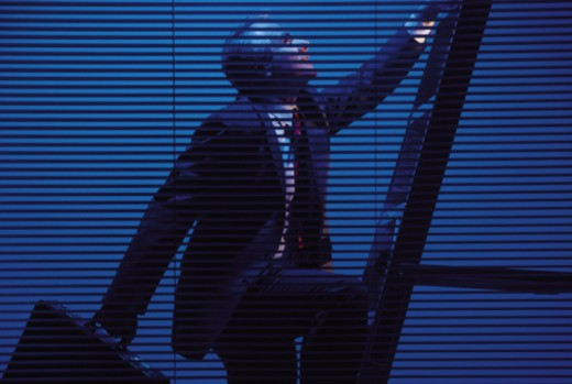 Stock Photo: 1557R-359189 Businessman climbing the corporate ladder