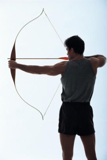 Archer aiming arrow : Stock Photo