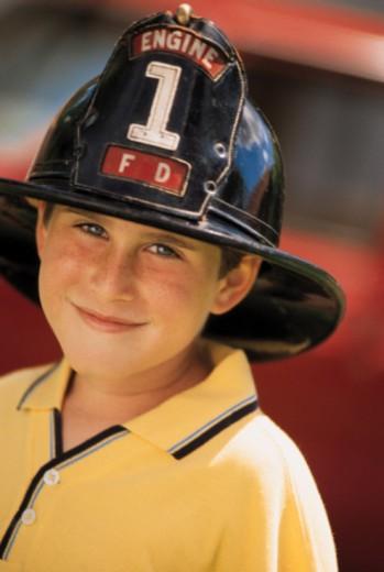 Boy wearing fireman's helmet : Stock Photo