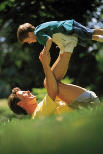 Stock Photo: 1557R-360265 Father and son playing outdoors