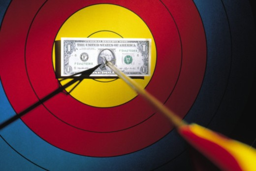 Stock Photo: 1557R-360496 Arrow through dollar bill on target