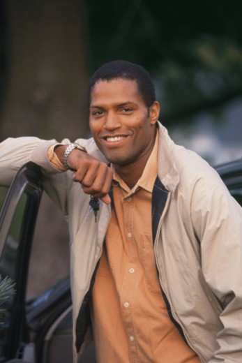 Portrait of man with car : Stock Photo