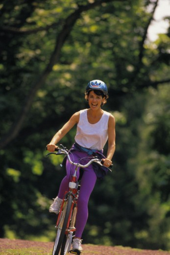 Stock Photo: 1557R-360689 Woman riding bicycle