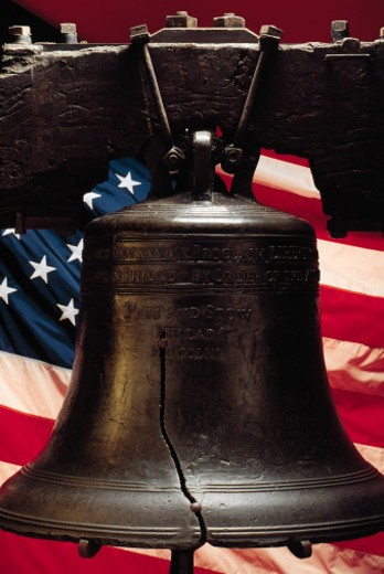 Liberty Bell with American flag : Stock Photo