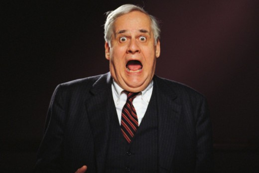 Stock Photo: 1557R-361437 Executive businessman with shocked expression