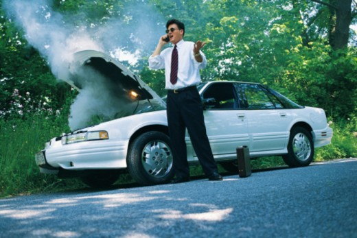 Man calling insurance agent for car trouble : Stock Photo