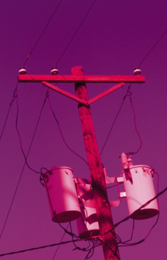 Telephone pole with transformers : Stock Photo
