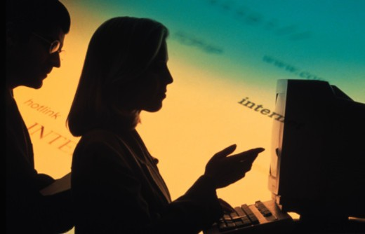 Silhouette of businesspeople at computer : Stock Photo
