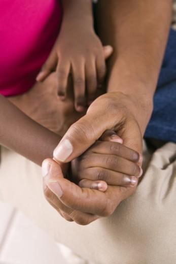 Man holding child's hand : Stock Photo