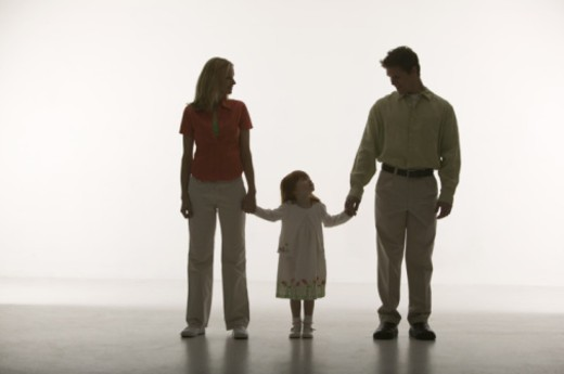 Parents holding hands with daughter : Stock Photo