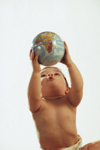 Baby holding globe : Stock Photo