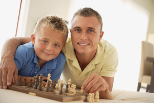 Stock Photo: 1557R-365953 Father and son playing chess