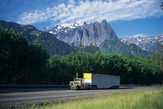 Semi-truck in the mountains : Stock Photo