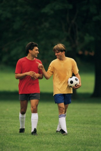 Stock Photo: 1557R-367042 Men playing soccer