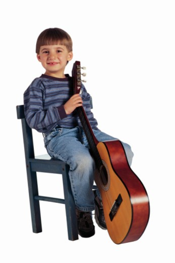 Boy with acoustic guitar : Stock Photo