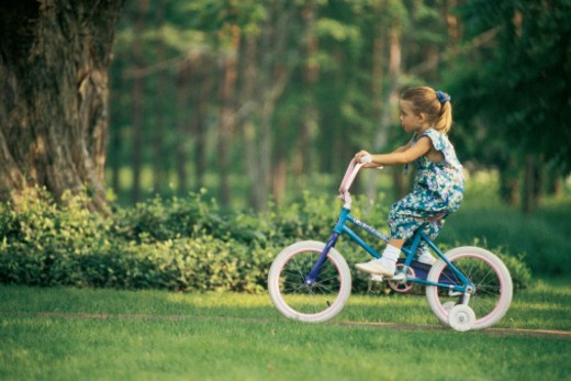 Girl riding a bicycle : Stock Photo