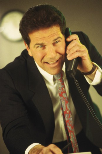 Stock Photo: 1557R-367914 Businessman talking on telephone