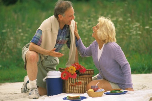 Stock Photo: 1557R-368566 Couple having picnic at the beach