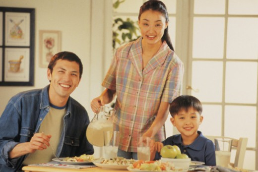 Family at kitchen table : Stock Photo