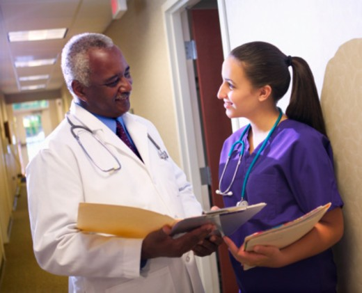 Doctor and nurse with file : Stock Photo