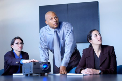 Businesspeople watching presentation : Stock Photo