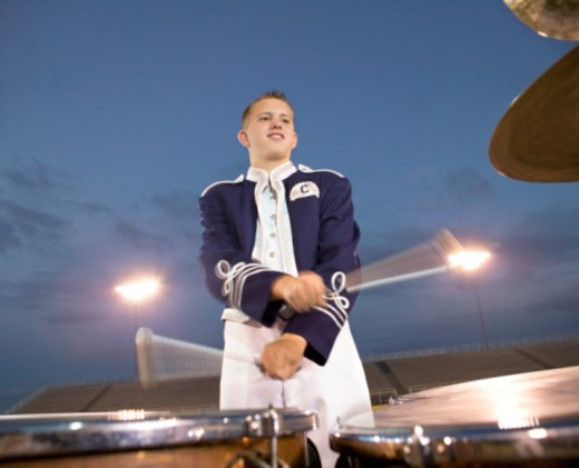 Percussion player in marching band : Stock Photo