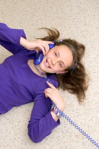Girl using telephone : Stock Photo