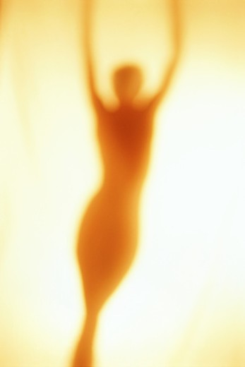 Blurred silhouette of nude woman : Stock Photo