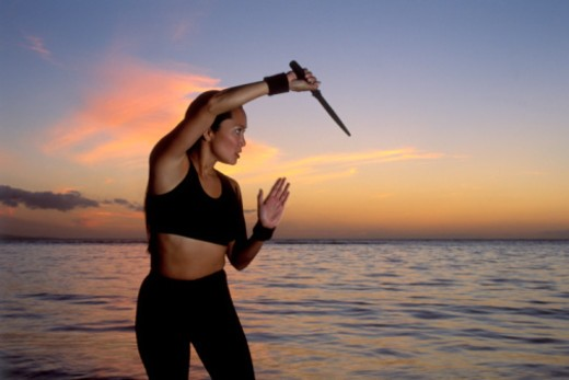 Woman doing martial arts at beach : Stock Photo