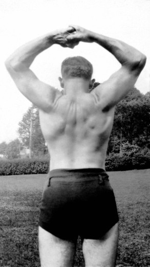 Stock Photo: 1557R-372263 Vintage image of man flexing back