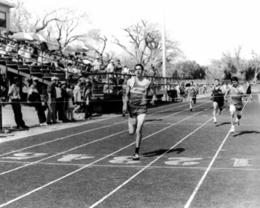 Stock Photo: 1557R-372378 Vintage image of runner crossing finish line