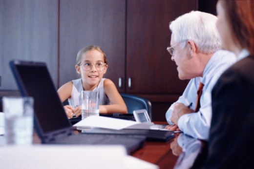 Girl leading business meeting : Stock Photo