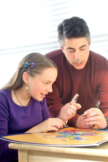 Stock Photo: 1557R-373714 Father and daughter with coin collection