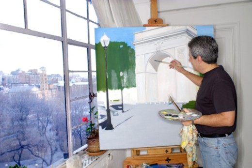Artist painting by windows : Stock Photo