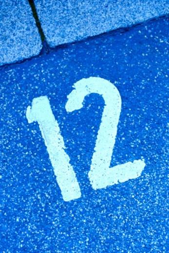 Number twelve on asphalt : Stock Photo