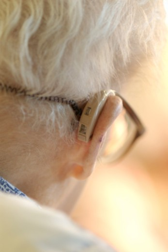Stock Photo: 1557R-374476 Close-up of elderly person with hearing aid