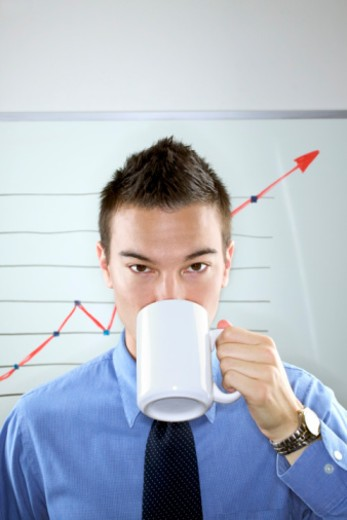 Businessman drinking coffee : Stock Photo