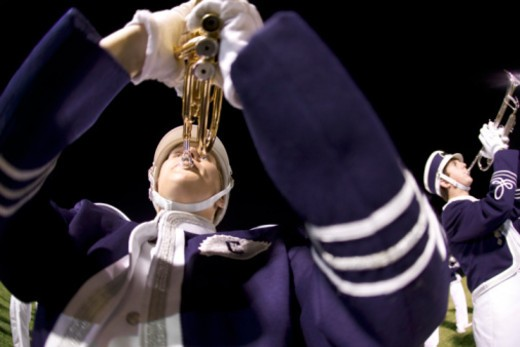 Trumpet player in marching band : Stock Photo