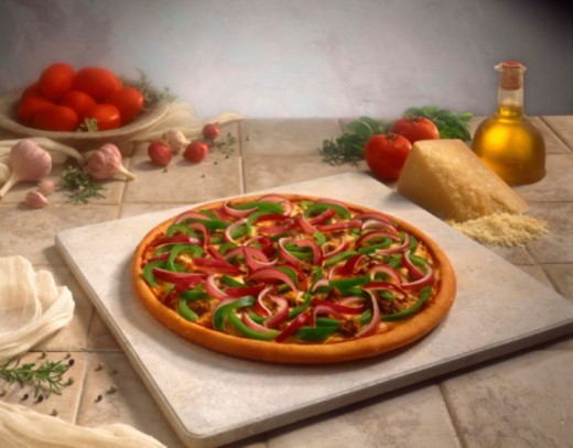 Pizza on stone : Stock Photo