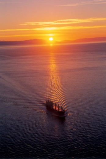 Aerial view of cargo ship at sunset : Stock Photo