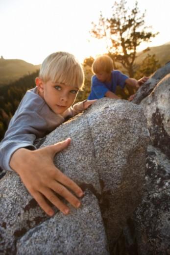 Stock Photo: 1557R-378941 Boys climbing rocks