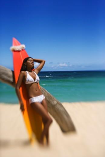 Teenage girl with surfboard : Stock Photo