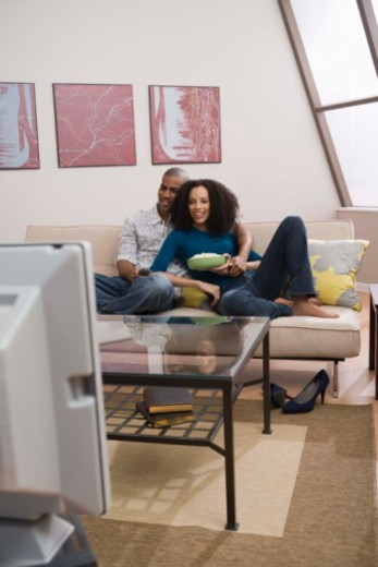 Stock Photo: 1557R-379171 Couple at home watching television