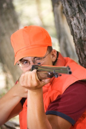 Hunter aiming rifle : Stock Photo