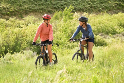 Women riding bicycles : Stock Photo