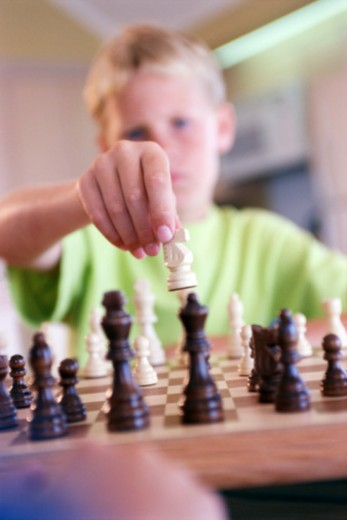 Stock Photo: 1557R-379983 Boy playing chess