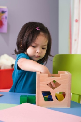 Toddler playing with blocks : Stock Photo