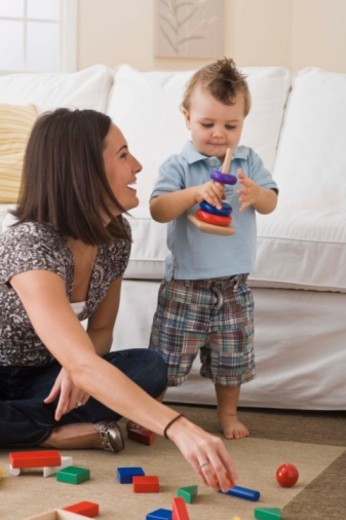 Mother and son playing with toys : Stock Photo