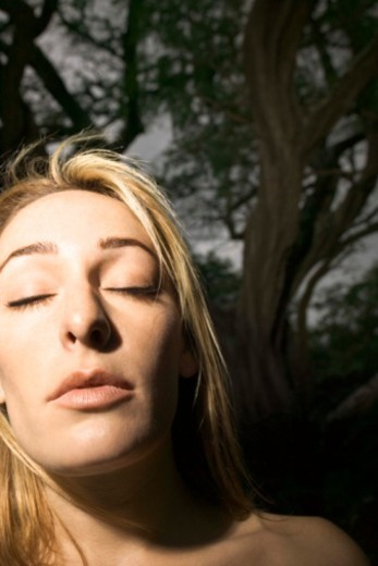 Stock Photo: 1557R-380835 Meditative woman in forest