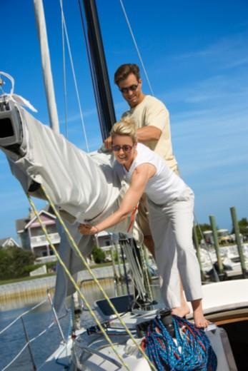 Couple on sailboat : Stock Photo